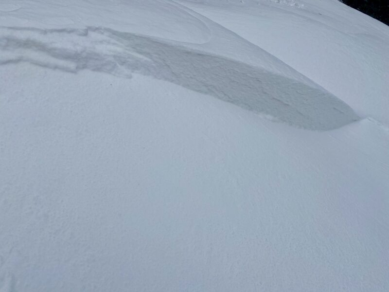 Example of a small isolated pocket of wind slab that we were able to release from the ridgeline. Notice that this slab failed within the transported snow and not on a buried weak layer of facets. This is an important distinction.