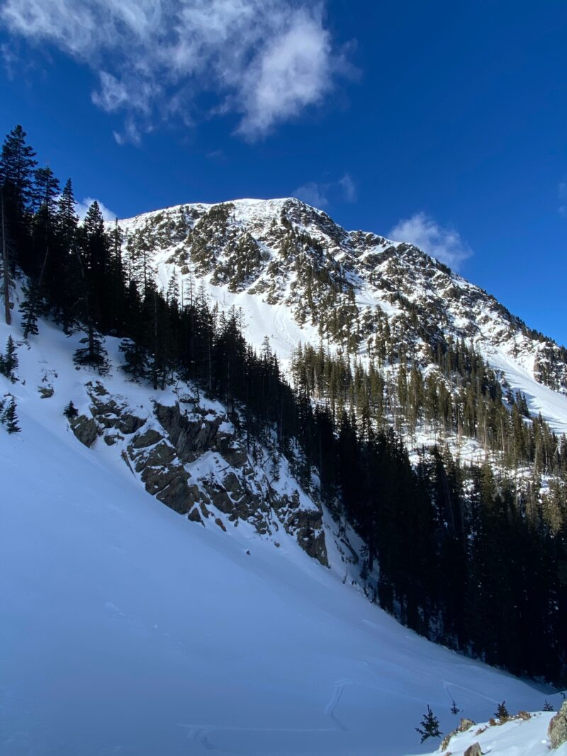 Small loose snow avalanche beneath the cliffs from 12/21