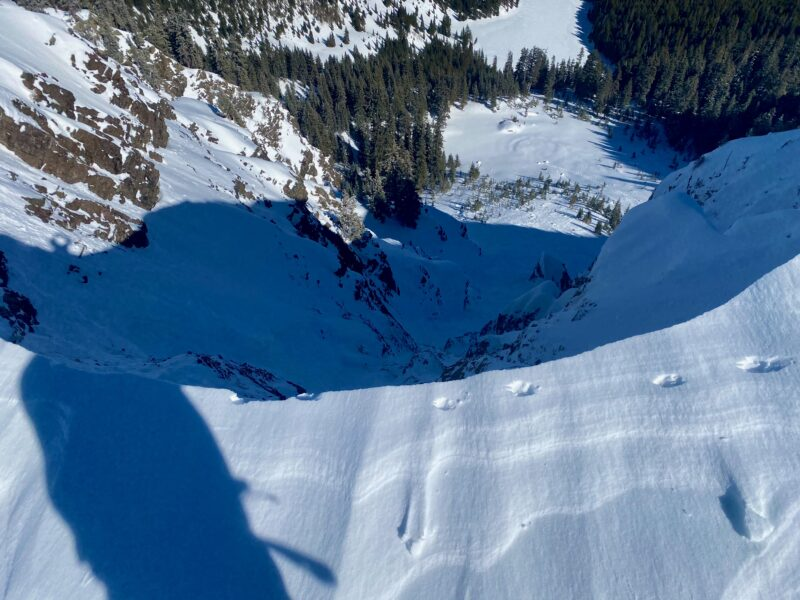 Overhanging cornice looks to have collapsed today, as the animal prints look fresh and there are large cornice chunks far down in the runout