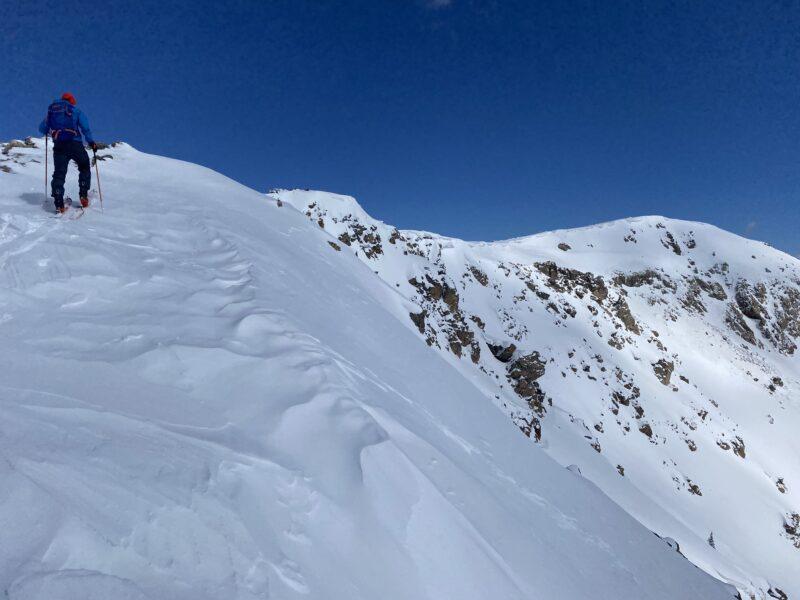 Allen Curano on Baldy summit ridge with summit in distance.